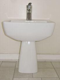 Wall mounted basin, mixer tap and semi-basin pedestal.