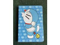 The Doraemon iPad mini case good condition and Collection only . .