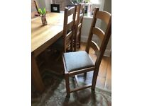 Farmhouse dining room table and 6 chairs. The table extends.