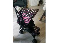 Cosatto pink bow stroller