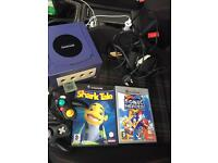 Gamecube and control and all the cables and two mint game look like new