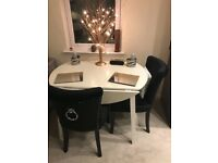 White Round Drop Leaf Dining Table plus Two Black Velvet Dining Chairs