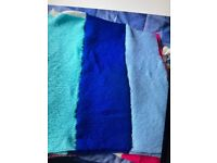 Knitted blankets available in various colours for use for babies animals and homeless