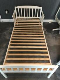 White toddler bed with mattress and bedding bundle