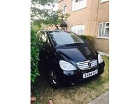 Mercedes Benz A class in black colour with Long a mot