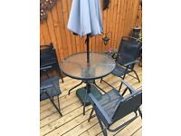Outside dining table and 4 chairs