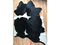 Ikea cowhide rug black