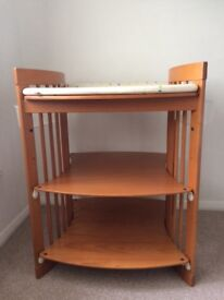 Stokke changing table and bath tub stand