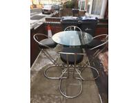 Lovely tall table with 4 lovely chairs great condition
