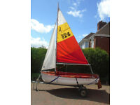Griffin Adventurer sailing dinghy with road trailer and folding launch trolley