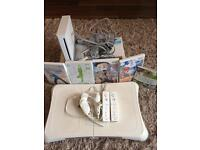 Nintendo Wii in white with games and accessories