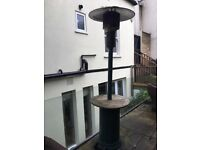 Patio Heater. Good condition with teak table. Propane tank included.