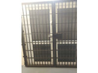 Wrought iron security gates/railings for shop or office front. Heavy duty gates