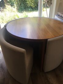 Round dining table - from dwell