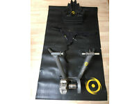 CycleOps Fluid Turbo Trainer. With mat, 2x raiser blocks and handlebar towel.