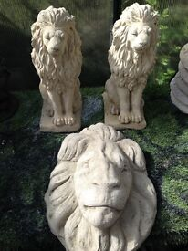 Huge solid lion heads and sitting lions