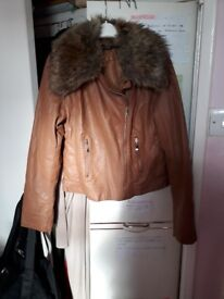 Leather jacket with thick fur neck. Beige colour. Size 12-14. Warm. New. Only £10.