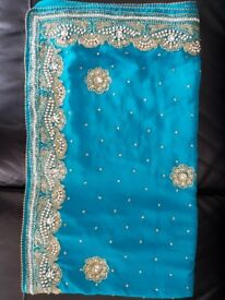 Turquoise saree with long sleeve blouse