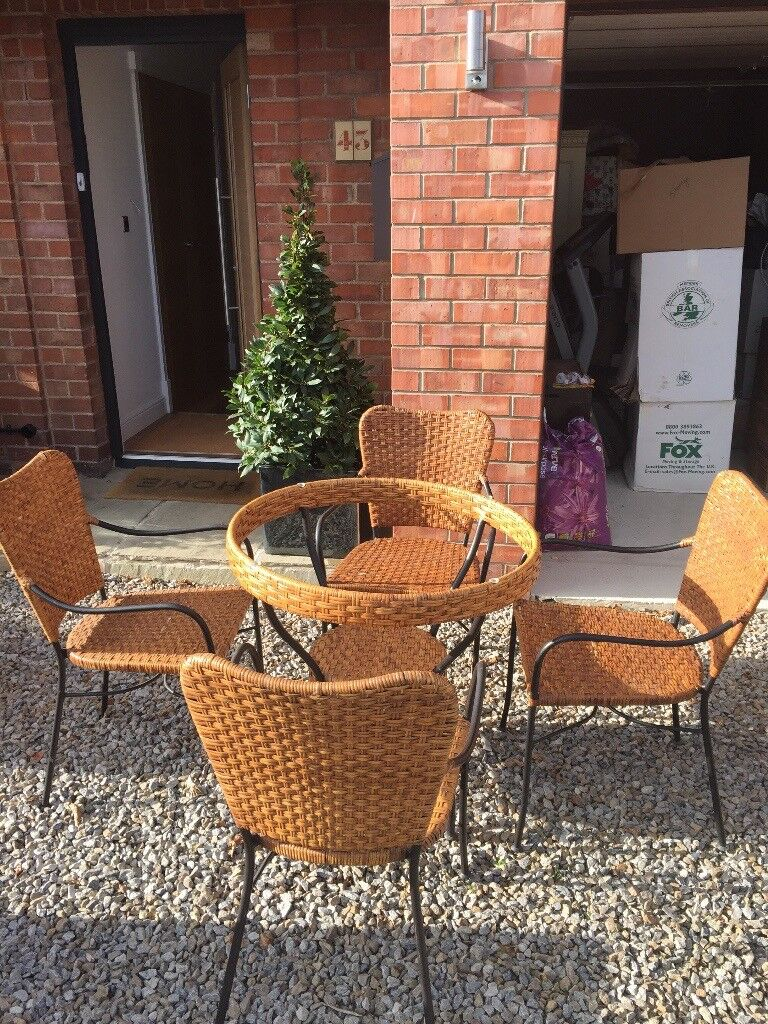 Conservatory Table and 4 Chairs Spencer's Glass Top Rattan Table and Tattan chairs. Good quality