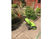 RARELY USED 1200 w lawn raker and scarifier in mint condition for sale