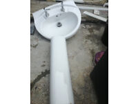 white bathroom basin with pedestal and tapes