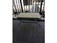 Black wrought iron chaise lounge
