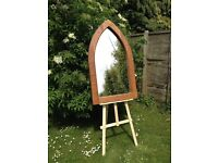 Solid oak gothic arched mirror.