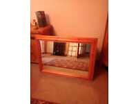 Large bevelled pine framed wall mirror.