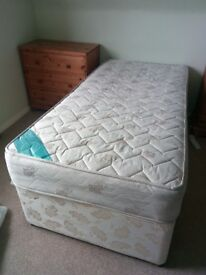 Single divan bed, with white metal head board. Free to collector.