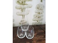 Carafe and two stemless glasses