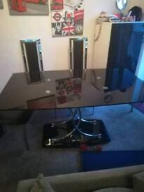 Black glass and chrome dinning table and 4 chairs
