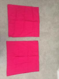 Two large bright pink pillow cases