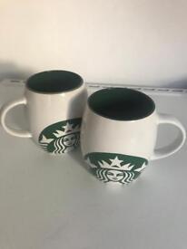2 Starbucks mugs