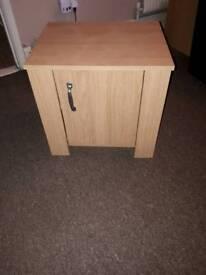 Two light oak cupboards