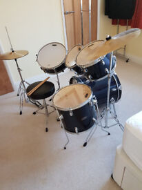 Mapex Tornado drum kit in navy. Includes hi-hat, crash symbol, pedals and sticks. Great condition.