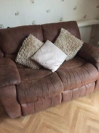 Tan leather 3 piece suite. All seats recline plus a rocker chair