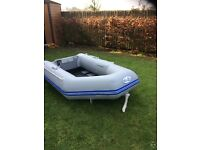 WAVECHO inflatable dingy .SunSport 12vt motor. As new . Never used.