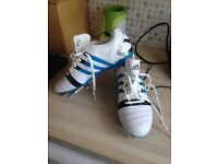 Men's size 7.5 brand new addidas rugby boots.