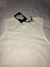 Ladies sleeveless cream small top