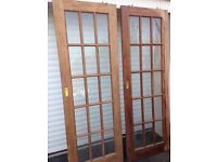 "Two wooden framed glass panel doors 27.3"" x 78.3"""