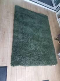 Brand new khaki next rug.