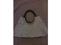 Striped material handbag