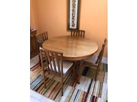 Solid Teak Round extendable dining table with Four Chairs