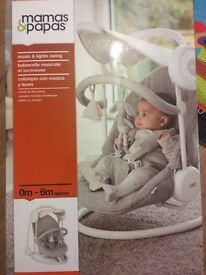 Mammas and Pappas baby swing chair , plays music and rocks and also has lights