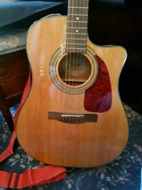 Fender acoustic guitar with electric outlet.