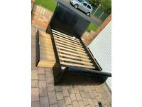 Black leather sleigh double bed with 2 large drawers
