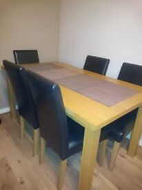 Dining table with 6 chairs in good condision