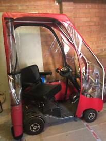 Disabled scooter with top