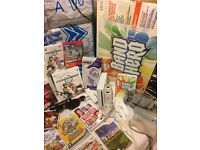 wii, wii fit board, 3 controllers, 3 nunchucks, Band Hero, dance mat, microphones, games, and more