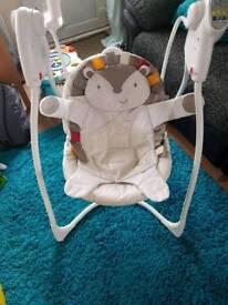 Baby swinging seat